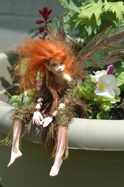 Fairy in a pot - probably tending the plants