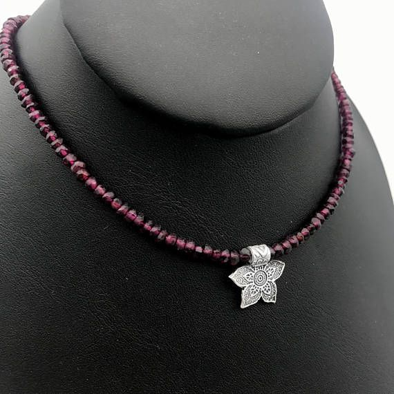 Are you feeling sluggish and disconnected? Garnet gemstones help you feel grounded and connected to the present moment. This garnet necklace is the answer. A simple fine silver flower dangles from a rich, deep red garnet chain. A wonderful gift for that January baby or anyone who