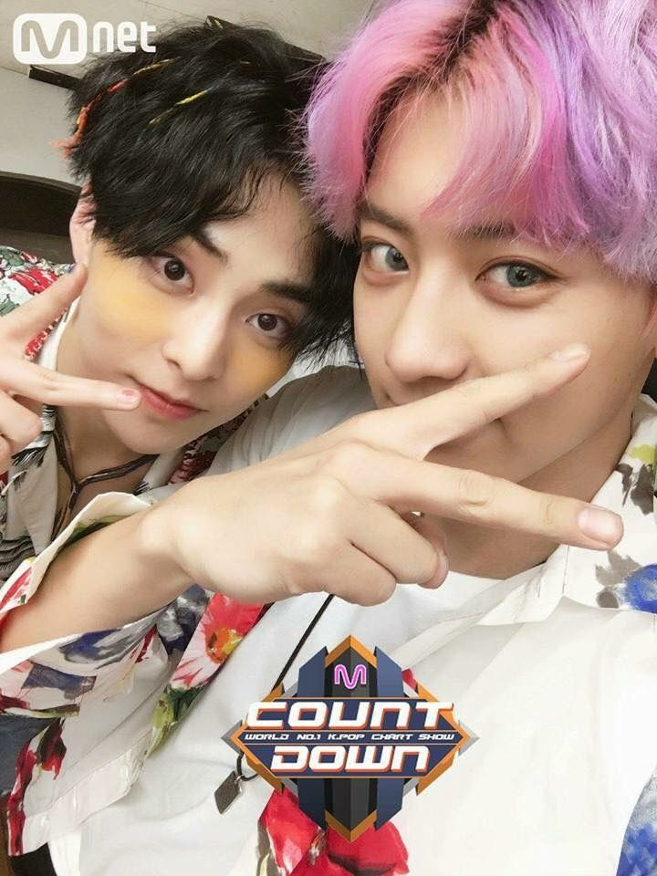 Xiumin -Chanyeol. Okay. Am I the only one that keeps staring at Chanyeol's long and smooth fingers? Yes? My god.