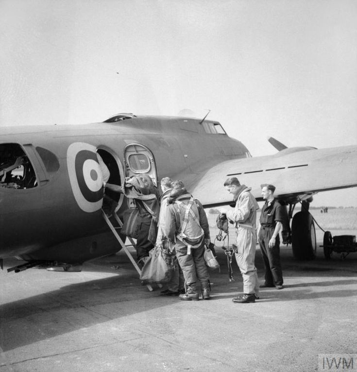 Aircrew of No. 90 Squadron RAF, board their Boeing Fortress Mark I at Polebrook, Northamptonshire, for an attack on the German Battlecruiser 'Gneisnau' docked at Brest, France