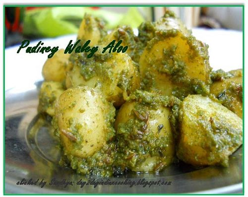 Baby potatoes simmered in mint sauce, indian chat recipe