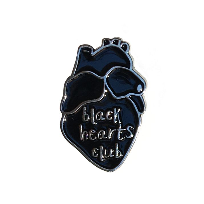 "Who needs love when we have sick pins to put on our jackets? Black realistic heart shaped enamel pin with silver colored outline and text reading ""black hearts"