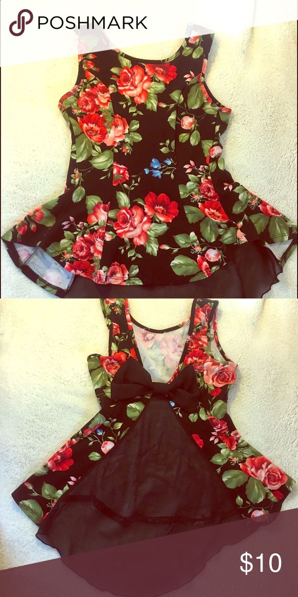 Medium Floral skin tight shirt . Floral , skin tight medium but it does shrink / enlarge to fit . Great condition , see through triangle back . Bow on back. Tops Blouses