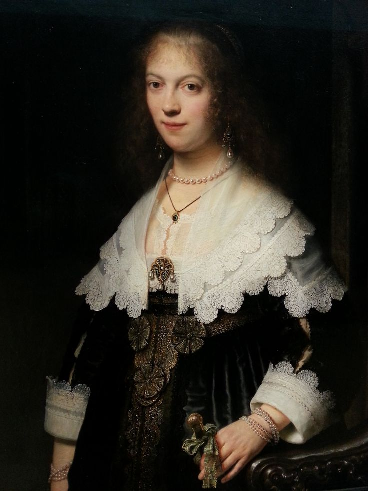 Portrait of a woman, possibly Maria Trip, by Rembrandt van Rijn, 1639. She was the daughter of a wealty Amsterdam merchant. Her dress is trimmed with white linen so fine, it is almost transparent. She sports a fortune in pearls, an in her left had she casually holds the knobbed handle of a folding fan. In 1639 this was still a rare and costly accessory. Rijksmuseum Amsterdam.