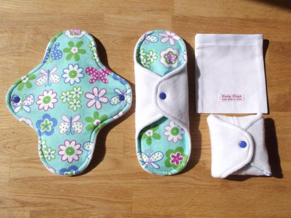 Lady Days This listing is for a set of three cloth menstrual pads and 1 carry bag. Suitable for medium flow, the pads are made up of five