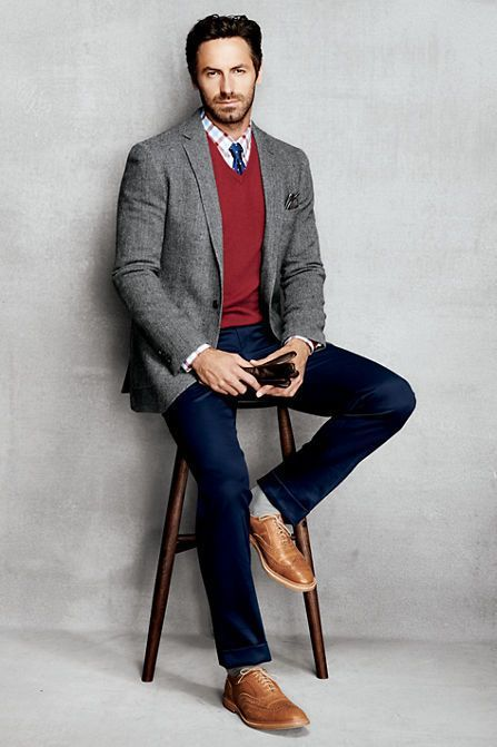 Chinos paired with a button down shirt and a V neck sweater. Also watch out 8 Extraordinary Ways to Wear a V Neck Sweater — Mens Fashion Blog - The Unstitchd