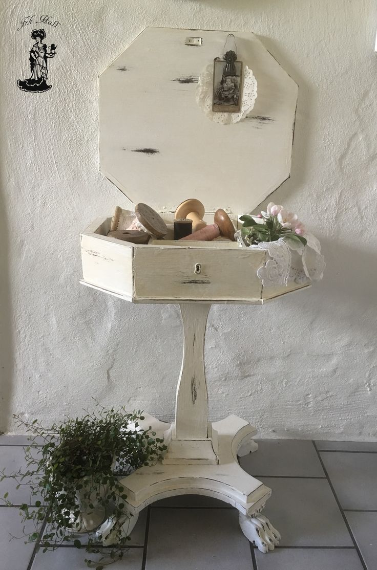 Very old white painted shabby chic sewing table. Very romantic and beautiful