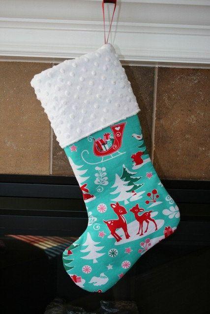 CHRISTMAS STOCKING - Red Reindeer on Aqua Christmas Stocking. $25.00, via Etsy.