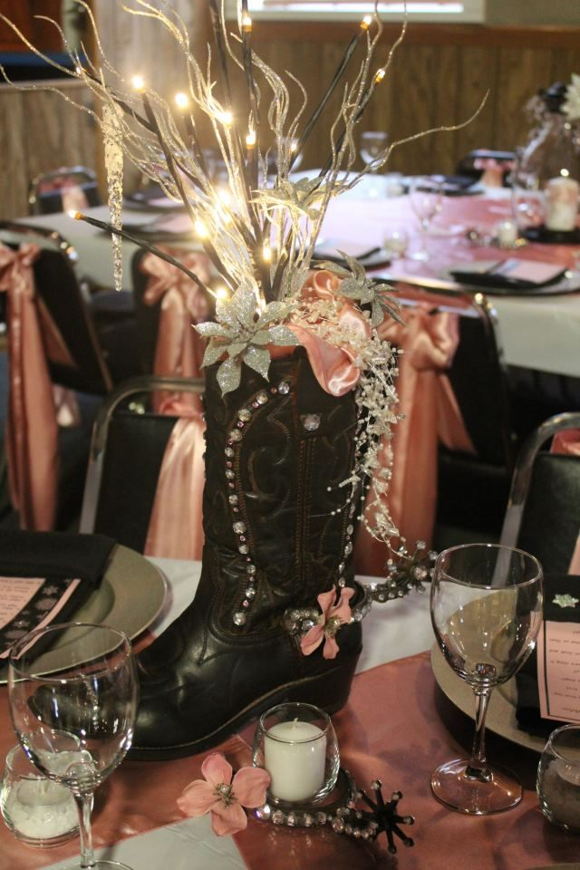 Cowboy boot centerpiece. This is like contemporary meets old western wedding. I love it!