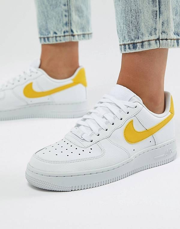 timeless design bb90f 99da1 Nike Air Force 1 Trainers In White And Yellow