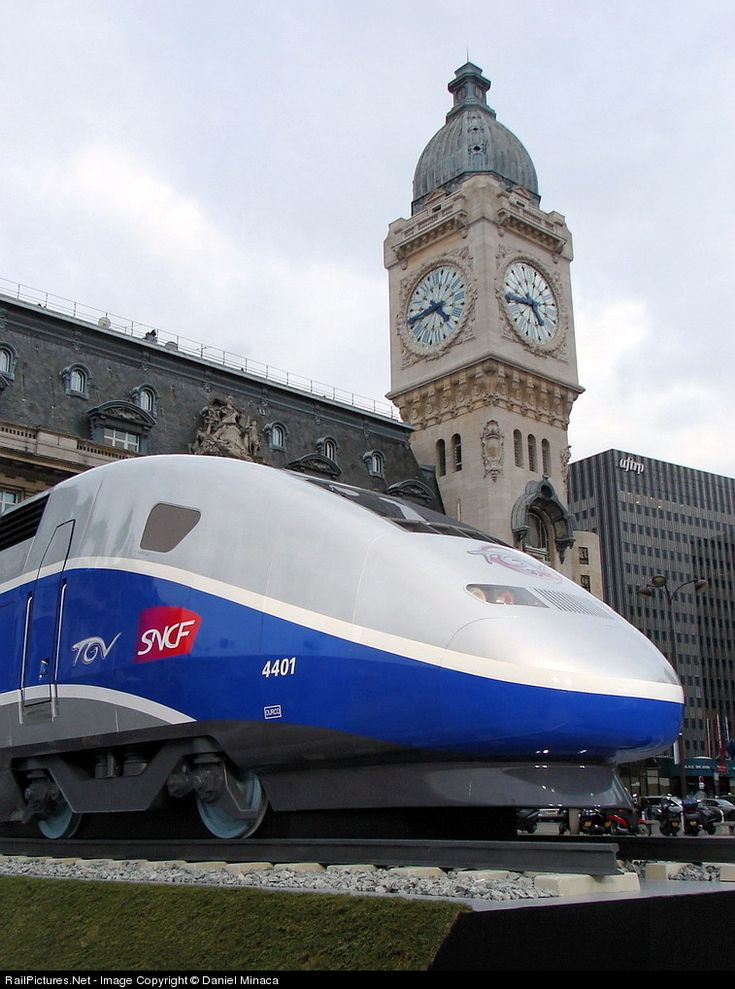 This picture was taken in front of the Gare de Lyon in Paris. This is a model that has been specially made ​​for the celebration of 25 years of the French TGV and represents the front cab of an high speed train locomotive. You can see the famous clock tower of this terminus station.