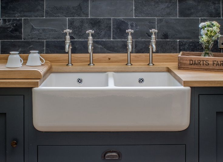 double farmhouse sink, slate subway tiles, inset cabinets painted in