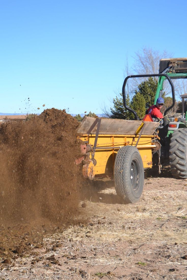 spreading manure - black gold for farmers