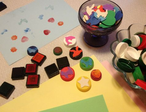 Stamps from recycled plastic caps and foam figures. Kids craft. DIY.