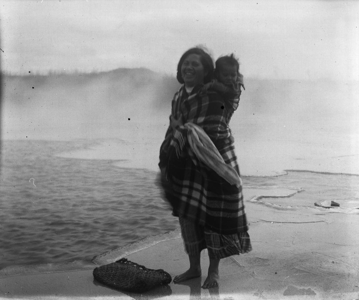 Maori woman and baby by thermal pool... 1909