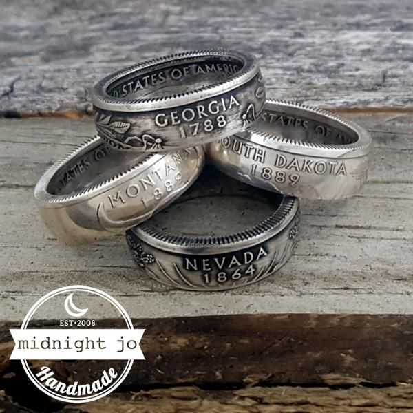 90% Silver State Quarter Coin Rings. These rings are handmade to order using actual United States silver proof quarters! Because of the high silver content these will not irritate your skin. These state quarter coin rings are great for gifts or souvenirs or just to rep your favorite state!  The shank (width of the ring) measures approx. 6 to 7mm. ********  NOTE: These are completely handmade, no two rings are exactly alike nor are they perfect. Antique finish is on the surface of the ring…