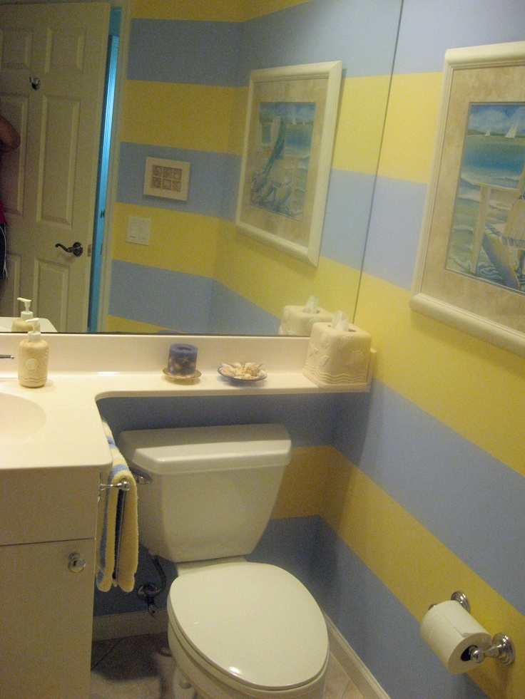 Small bathroom with blue & yellow large horizontal striped walls