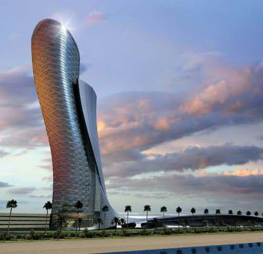 The Capital Gate building in Abu Dhabi reminds me of a certain kind of Danish pastry for some reason - perhaps the cone one with apple inside - anyway it stands at an angle of 18 degrees (apparently a world record..)