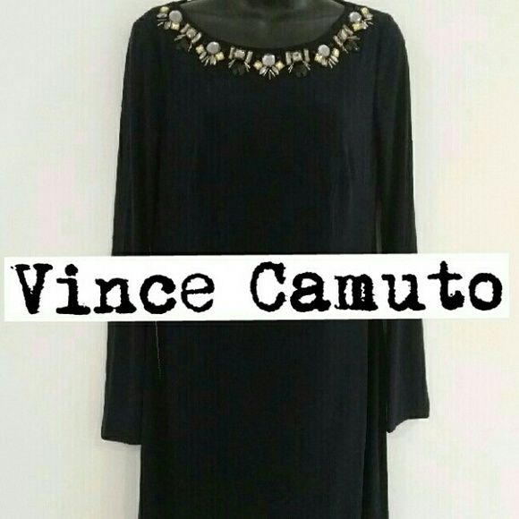 Vince Camuto navy sleeve dress, BNWOT, tag felloff Zipper is gold and comes with the matching Vince Camuto symbol. Show 95% polyester. 5% spandex. Lining 100% polyester. Hand wash cold. Do not bleach. Flat dry. May be dry cleaned. No iron or steam on beads. No modeling. No trades. No paypal. Please use the offer button when negotiating a price. Measurements from shoulder down to the bottom hem: 36 inches. 28 inches from armpit down to hem. Bust: 18 inches on one side. Sleeve from top of…