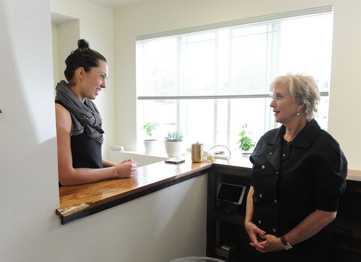 Linda McMahon, head of the U.S. Small Business Administration, right, visits with Heather Kelly, owner of Heather's Choice, in South Anchorage on Thursday. (Bob Hallinen / Alaska Dispatch News)