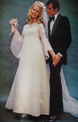 1970s wedding dress. I love the high neckline and wide sleeves, it's an adorable dress with gorgeous detail.