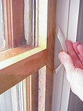 Build an interior storm window from wood and shrink film