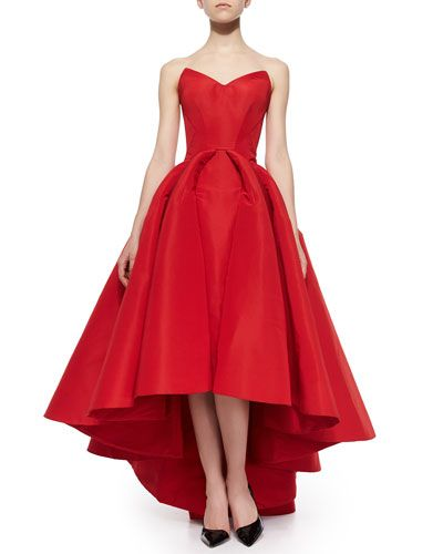 """Zac Posen Strapless Cat-Ear-Bodice High-Low Gown in Grenadine, $9,490 US.  This item is one of Ken's Pre-Fall Picks.  """"Your heart will skip a beat in this wonderfully red high-low hemline gown."""" - Ken Downing, Neiman Marcus Fashion Director"""