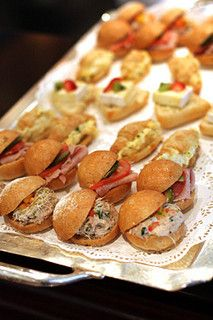 tea sandwiches / mini crossiants, rolls. All go well with the perfect cup of your favorite tea.