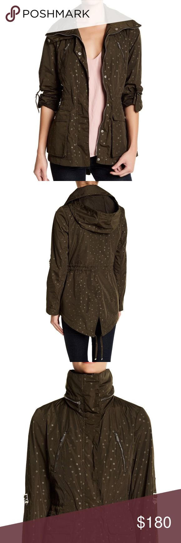 bcbgeneration // polka dot anorak NWT BCBGeneration military green hip-length jacket with all over polka-dot print, stowable hood, stand collar, interior and exterior drawstrings. Fully lined. Sold out everywhere! BCBGeneration Jackets & Coats