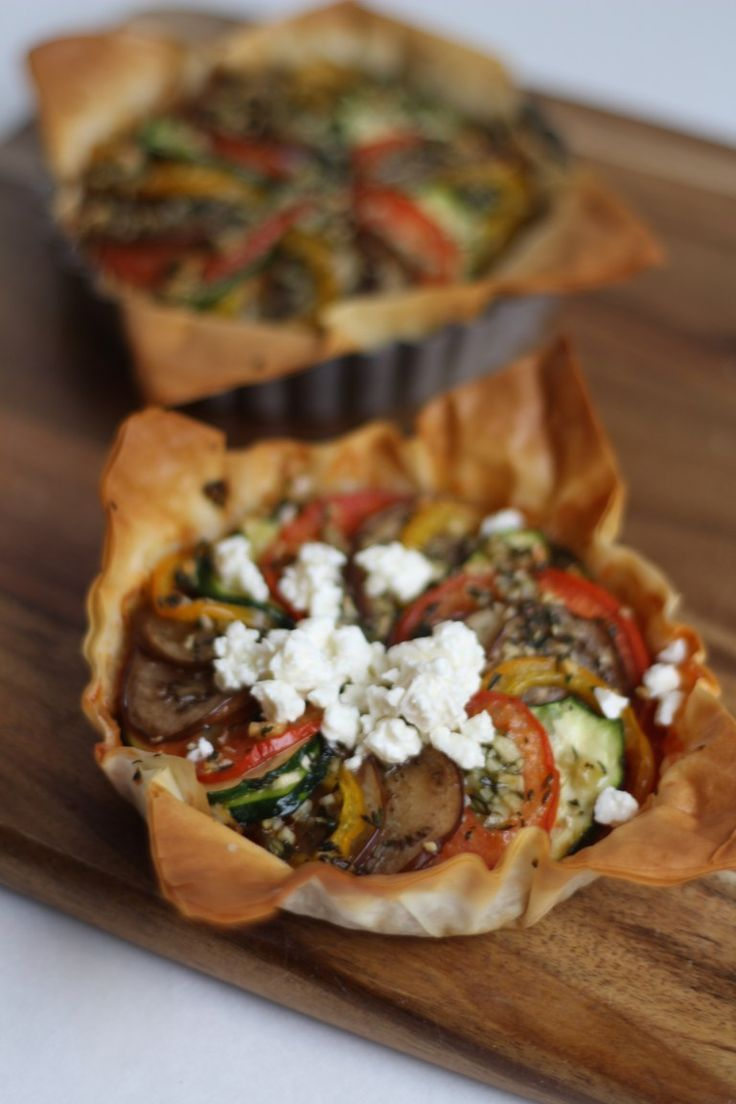 These gorgeous ratatouille tart makes an excellent side dish to any meal. Impress the guests at your next dinner party with these delicious little tarts. Even veggie haters will love these - just don't tell them there's eggplant in them :)