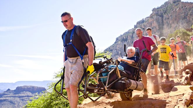 Meet the amazing family of Bob Headings. 8 grandsons and 3 adults carried Bob all the way down into the Grand Canyon and back up again...in his wheelchair. Read their full story here: http://www.suitcasesandstrollers.com/interviews/view/hiking-grand-canyon-with-kids-wheelchair?l=all #GoogleUs #suitcasesandstrollers #travel #travelwithkids #familytravel #familyholidays #familyvacations #traveltips #hiking #wheelchairs