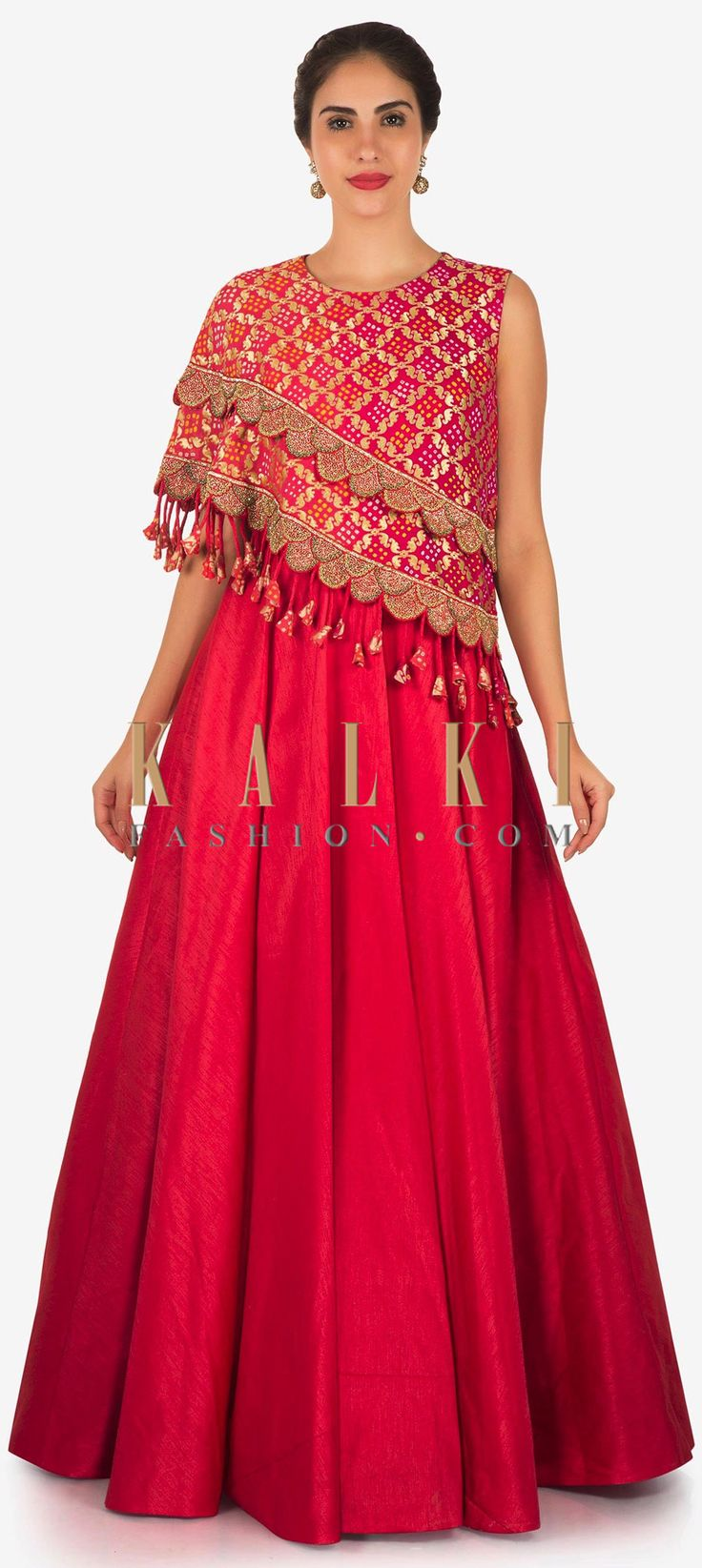 Buy Online from the link below. We ship worldwide Click Anywhere to Tag Rani pink anarkali gown with fancy bodice highlighted in lace and tassel only on Kalki  Featuring rani pink gown in silk with fancy bodice. Its enhanced in gold lace along with fancy tassel at the end. Slight variation in color is possible.