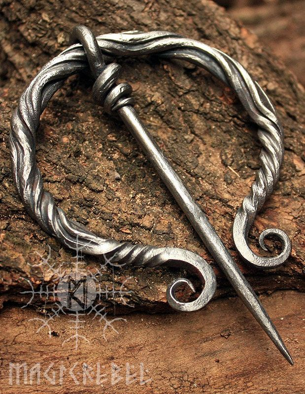"This is a forged iron Viking-Era Medieval Nordic Renaissance style fibula pin brooch. The fibula can be used as part of a reenactment costume.  Fibula width size is 3.15"" inches or 80 mm, pin length is 4.5"" inches or 118 mm. Fibula is coated by a water resistant finish to protect it from rusting.  #magicrebel #forged #iron #fibula #pin #viking #medieval #nordic #brooch #costume #reenactment #larp #jewelry"