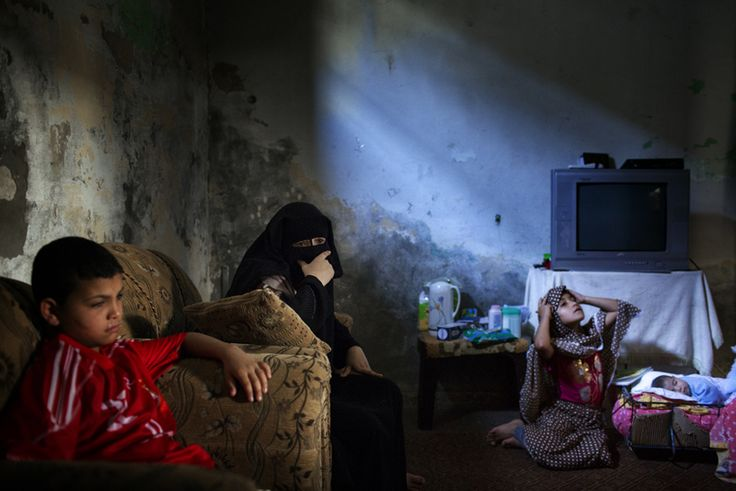 """Paolo Pellegrin    """"Twelve-year-old Khamis Abu Arab (at left) was playing outside when he found an undetonated shell. He brought it home, where it exploded in his face. A series of operations in an Israeli hospital removed shrapnel from his eyes but couldn't restore his sight. Gaza, Palestine 2011"""""""