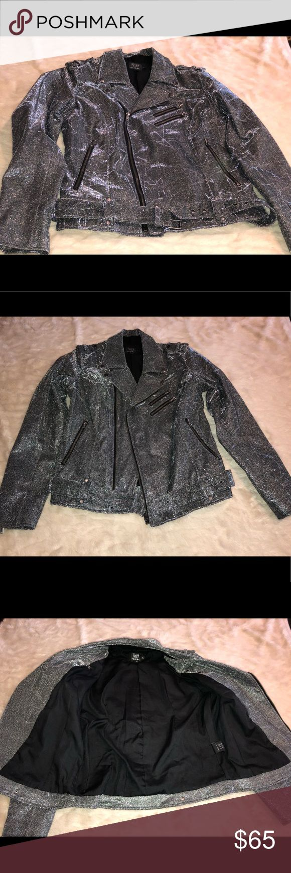 Tripp NYC silver shine on moto jacket glitter XL Worn literally only 3 times( I lost a lot of weight and doesn't fit anymore). Tripp shine on silver/gray tinsel moto jacket size XL. Front zip closure with belt with zippers on sleeves. You'll definitely turn heads in this number!  All items come from smoke free home. 🐺Husky friendly environment. All items are kept in plastic containers, but shed happens 😊 Tripp nyc Jackets & Coats