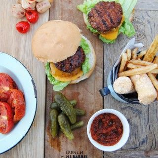 BBQ biltong beef burgers topped with caramelized onions, peppadew poppers and roasted tomato relish, a  #recipe by Lara Johnson #freshlyblogged #picknpay