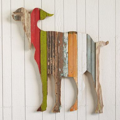 "BILLY THE GOAT -- Art that stands apart from the herd—our colorful goat, handcrafted from reclaimed wood boards, each retaining its original paint, grooves or routing. Hook for hanging. 31""W x 1-1/2""D x 32""H. Additional shipping."