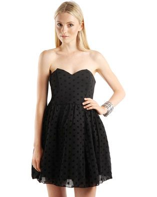 You can never go wrong with a little black dress. The Polka Dot Prom Dress Black by Rare London is a timeless piece that will keep your look relevant and elegant. It boasts a sweetheart neckline and fitted bodice, while the skirt flares out mid-waist. The polka dot print adds a quirky touch, while the double-layered fabric gives it a sense of flamboyance. Pair it with a sparkly clutch and a pair of bright heels for an effortlessly glam ensemble.