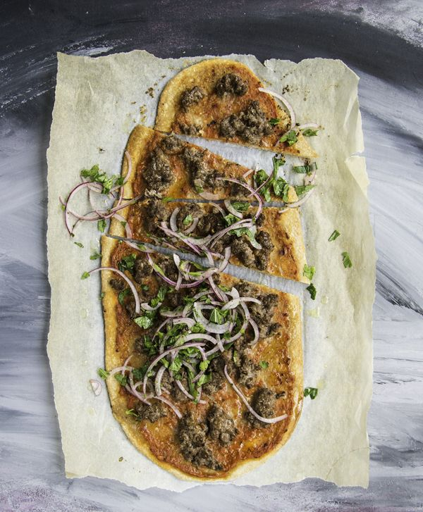 Lamb pide with herb & onion salad