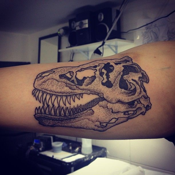 A dot work tattoo of a dinosaur skull by Gregorio Marangoni « « Ratta Tattoo
