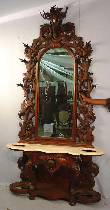 Found on EstateSales.NET: 1101 - Walnut  Victorian hall tree with white marble top heavily carved with deer head on top.