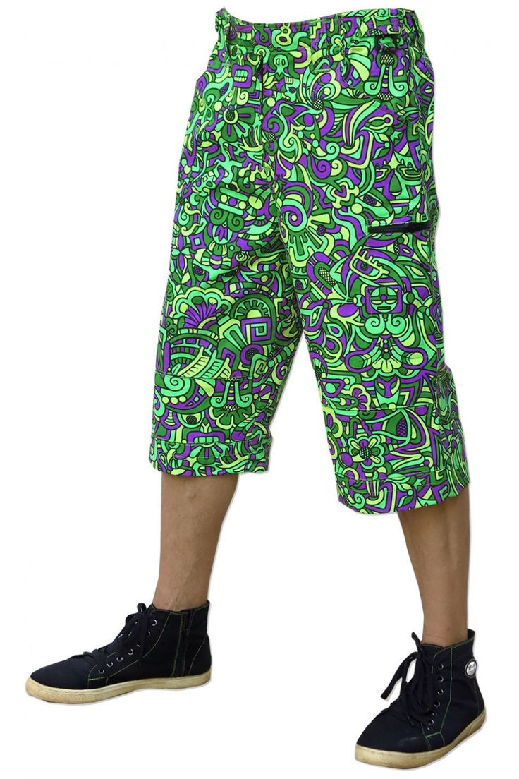 Cyber Shorts : Lime Mayan Fully printed men's 3/4 length shorts. Featuring: 2 front pockets, 2 zip pockets on leg & 2 zip back pockets. Elasticated waistband for super comfy fit, plastic key holder. Secure clip & magnetic closing on waistband. UV Active ! 100% cotton. Artwork by Adi