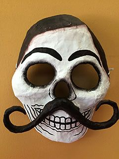 Paper mache procession mask - Bigotes - smiling male skeleton with brown heair and a huge mustache