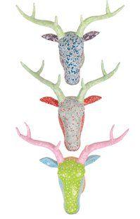 Paper mache deer heads found on minordetails.typepad.com