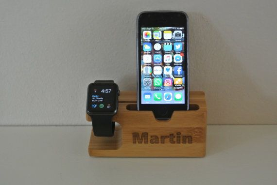 Wooden engraved iPhone apple watch docking station Suitable for apple watch or similar. The phone slot will fit an iPhone 4, 4S, 5, 5S, 6 6S, 6plus & SE  Perfect for gadget lovers, store/charge your gadgets in style. You can charge them using this stylish stand as well as using them for storage. Name engraved on the front included in the price, please message me with your chosen name when you order.  PLEASE NOTE IPHONE & APPLE WATCH IS NOT INCLUDED AND NO CHARGER THIS LISTING IS FOR A…