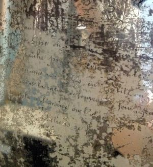 DIY:  Decoupaged Mirror - this is such an awesome project!!!  This blogger simply decoupaged script onto the reverse side of an aged mirror! by rachelle