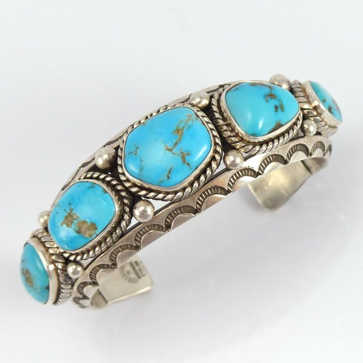 "Sterling Silver Cuff Bracelet with Stamped Designs and set with a Row of Natural Morenci Turquoise from Arizona. 1.125"" Cuff Width 6"" Inside Measurement, plus 1.375"" opening (7.375"" Total Circumferenc"