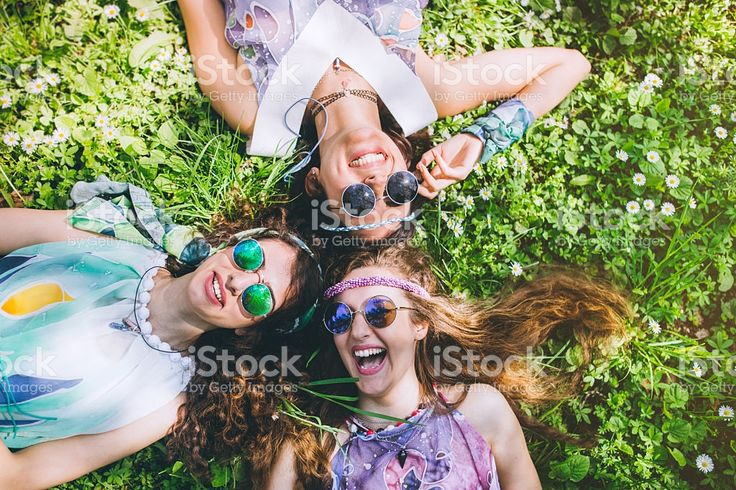 Smiling faces of hippie female friends royalty-free stock photo