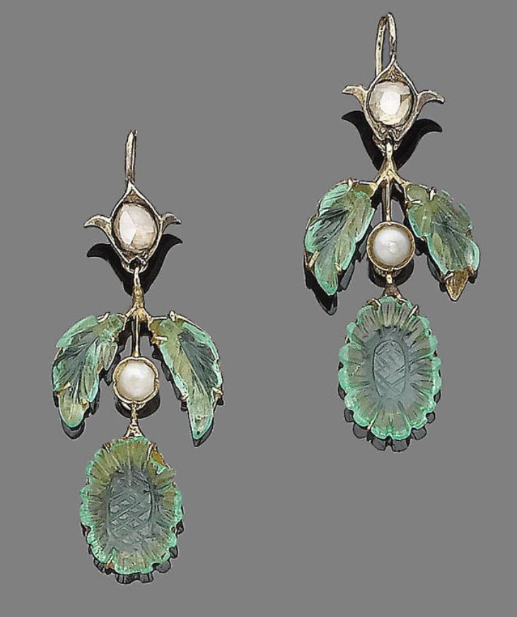 A pair of pearl, emerald, and diamond pendant earrings.  Each of foliate design, set with either a rose or old brilliant-cut diamond in closed-back settings, suspending carved emerald leaves and flowerheads, centrally-set with a 4.7mm pearl, damage to emeralds, pearls untested, length 4.6cm