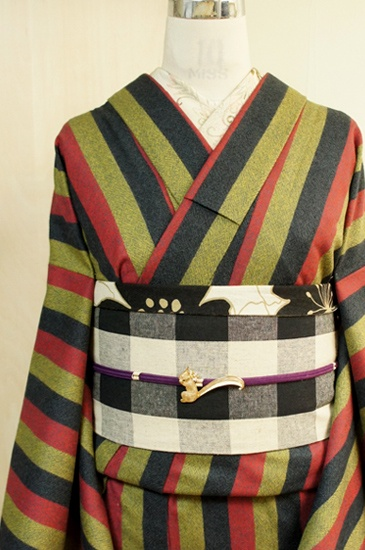 Wide stripes of red and yellow ash black wool single kimono fabric panel is retro-modern.